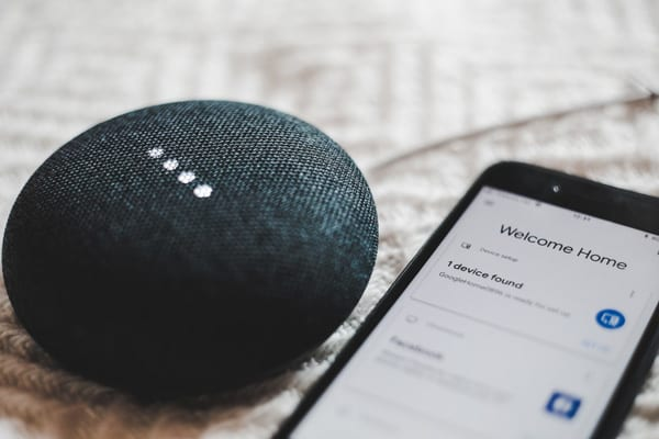 Google Home device and Google Home app on iPhone using artificial intelligence applications