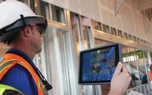 Use augmented reality in construction to visualize pipes behind walls.